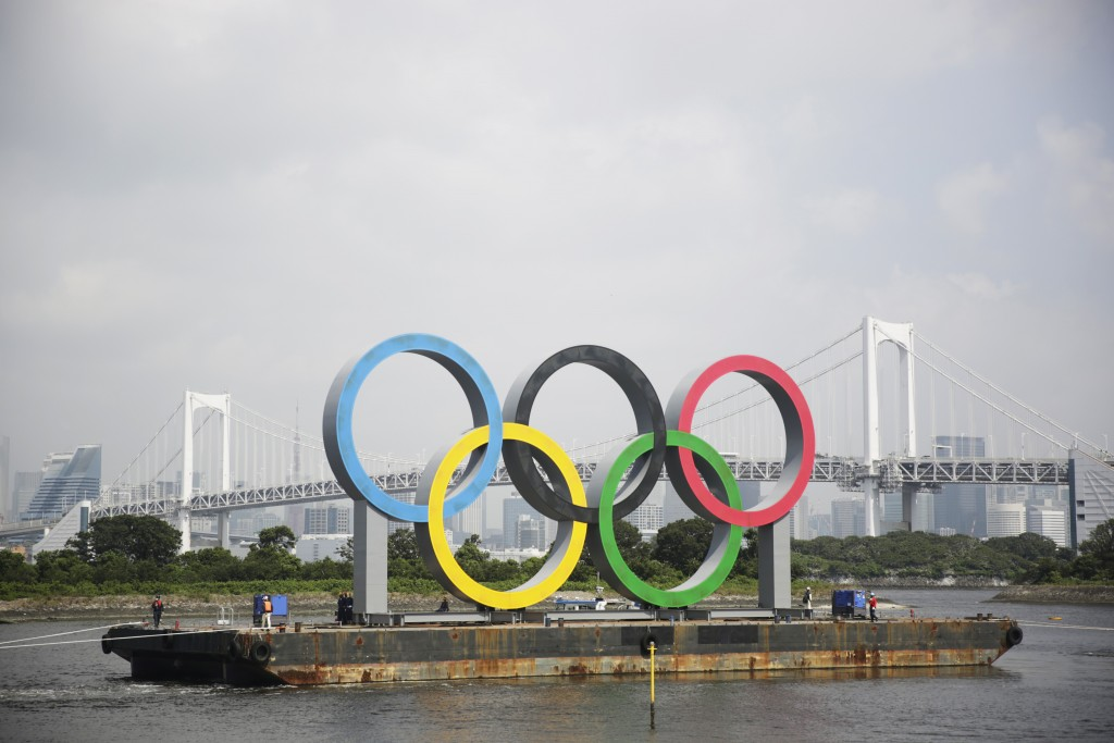 A symbol installed for the Olympic and Paralympic Games Tokyo 2020 on a barge is moved away from its usual spot by tugboats off the Odaiba Marine Park...