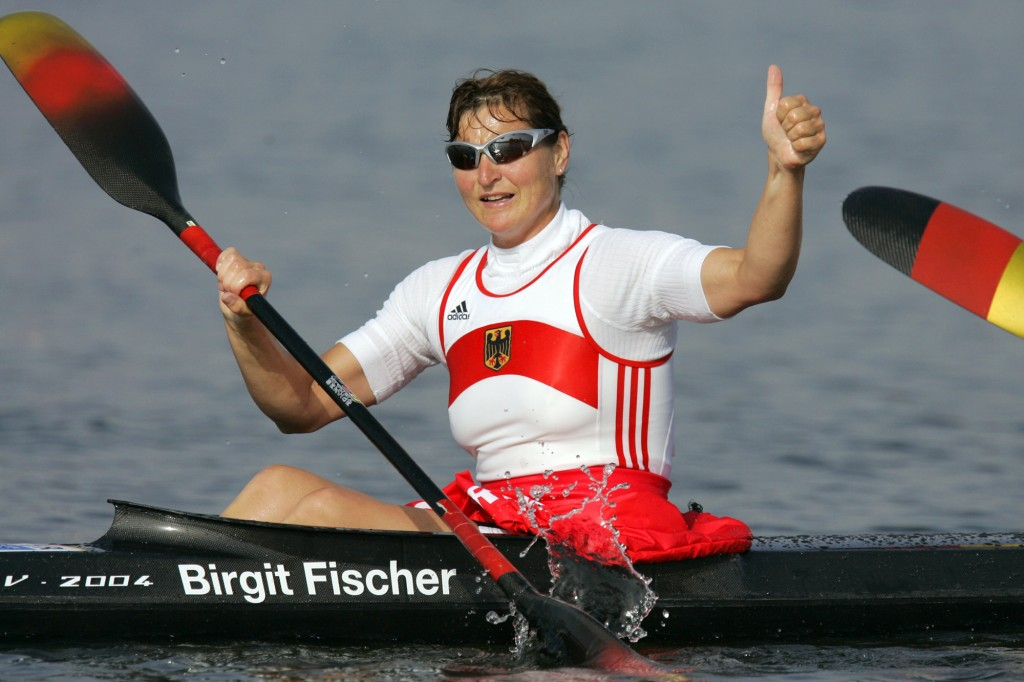 FILE - In this Aug. 27, 2004, file photo, Germany's Birgit Fischer celebrates after she and her teammates won the Women's K4 500 meter final to take t...