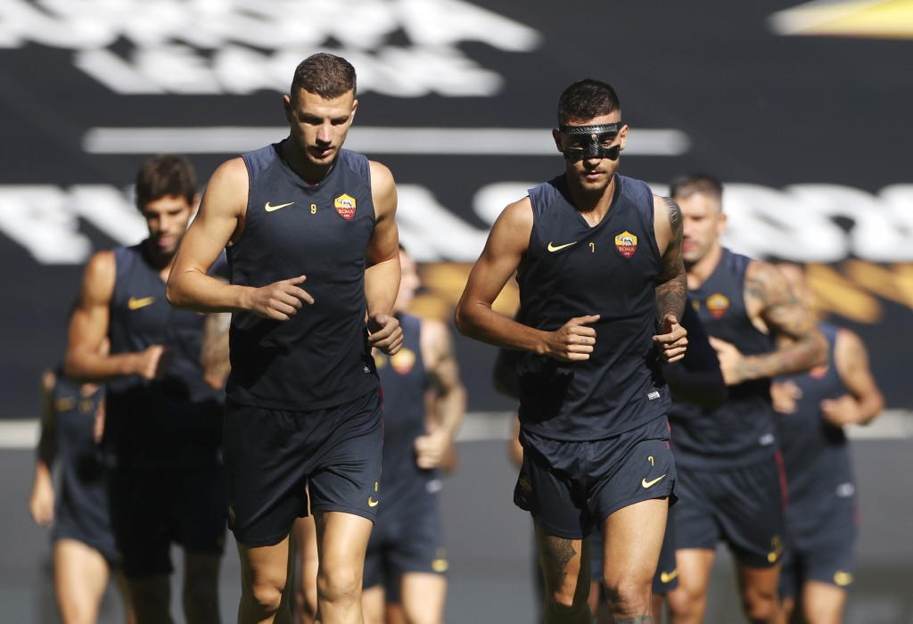 Roma's players warm up during a match day -1 training session in Duisburg, Germany, Wednesday, Aug. 5, 2020. AS Roma will play against FC Seville in a...