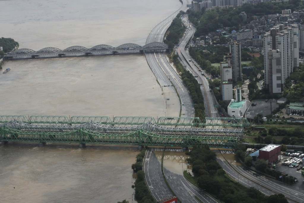 A part of a main road near the Han River is flooded due to heavy rain in Seoul, South Korea, Thursday, Aug. 6, 2020. Torrential rains continuously pou...