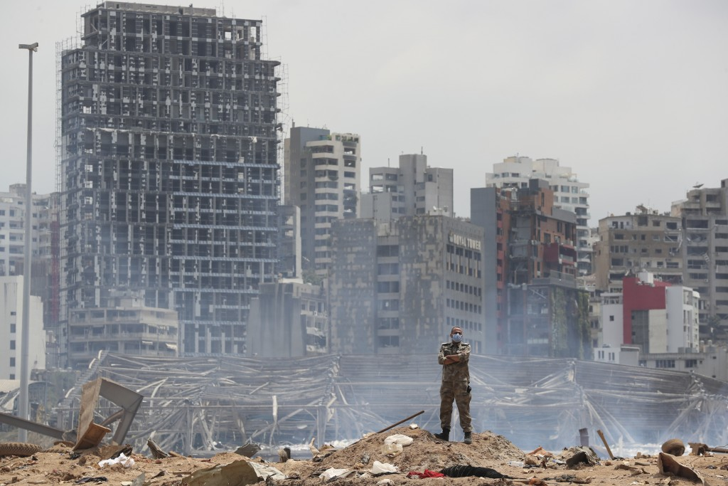 A soldier stands at the devastated site of the explosion in the port of Beirut, Lebanon, Thursday, Aug. 6, 2020. French President Emmanuel Macron came...