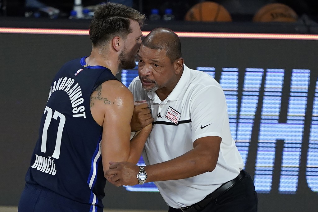 Dallas Mavericks' Luka Doncic (77) talks to Los Angeles Clippers head coach Doc Rivers after an NBA basketball game Thursday, Aug. 6, 2020 in Lake Bue...