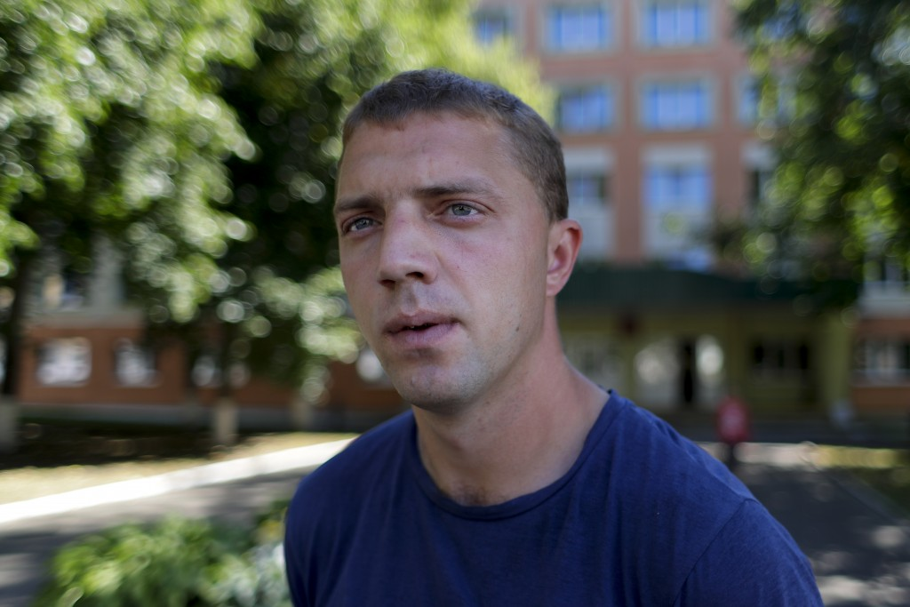In this photo taken on Friday, Aug. 7, 2020, Pavel Paleichik, an ambulance doctor speaks during his interview with the Associated Press in the western...