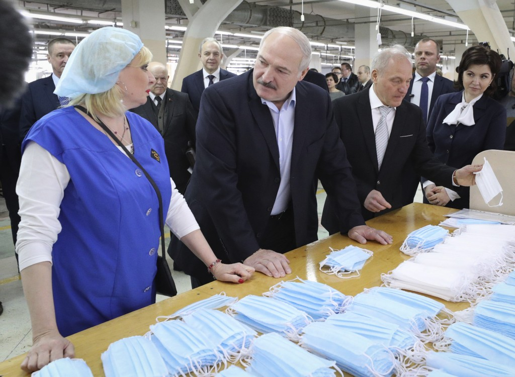 FILE In this file photo taken on Tuesday, April 21, 2020, Belarusian President Alexander Lukashenko talks with an employee during his visit to sewing ...