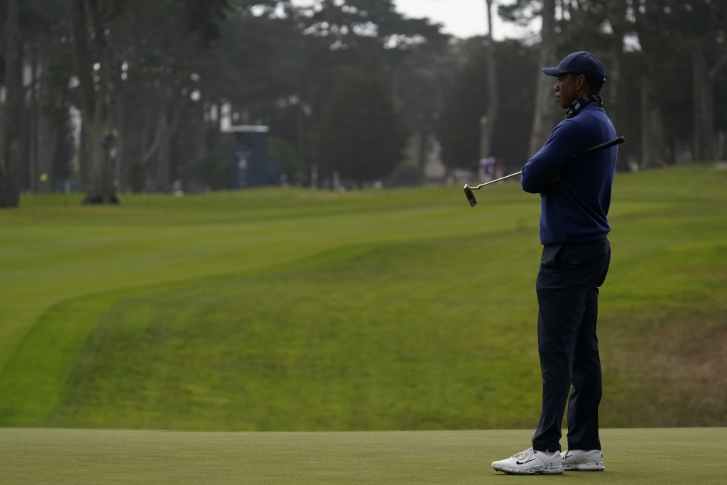 Tiger Woods waits to putt on the 15th hole with no gallery in the fairway behind him during the first round of the PGA Championship golf tournament at...