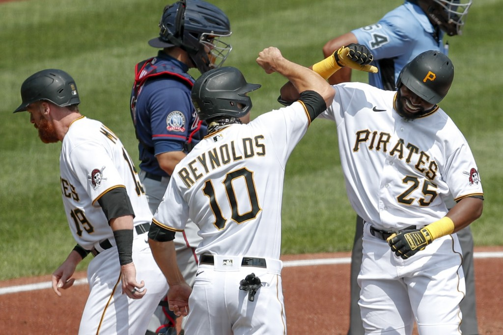 Pittsburgh Pirates' Gregory Polanco (25) celebrates with Bryan Reynolds (10) and Colin Moran (19) after Polanco hit a home run scoring them in the sec...