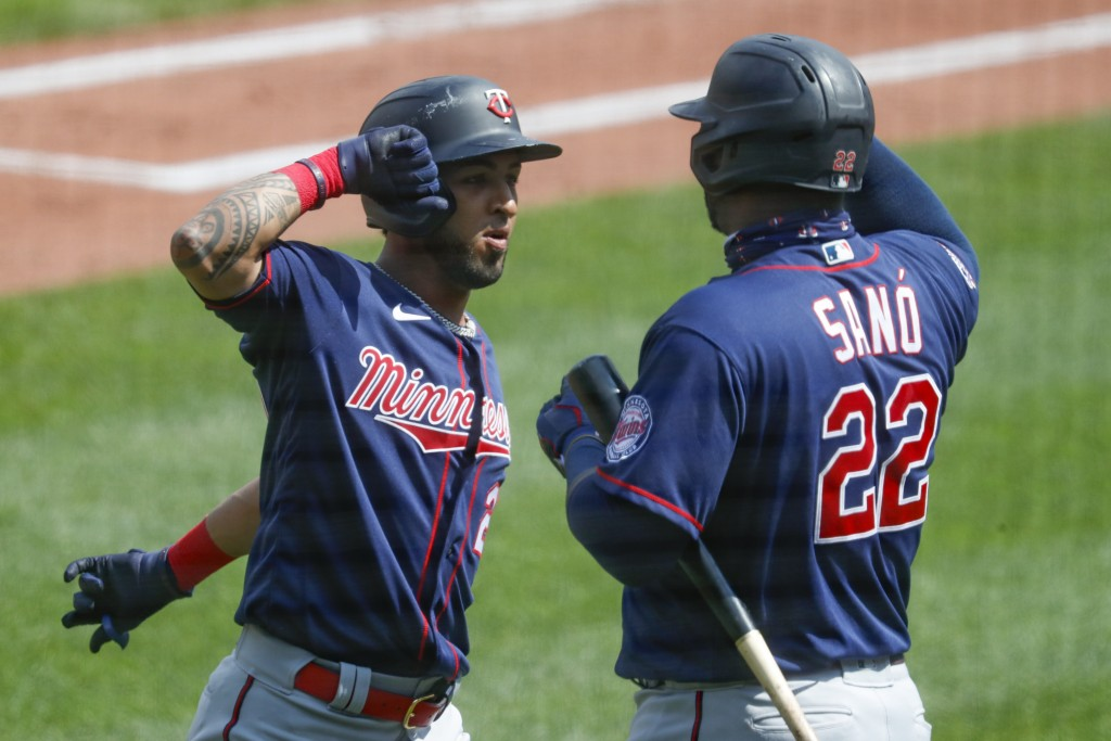 Minnesota Twins' Eddie Rosario, left, is greeted by Miguel Sano (22) after hitting a solo home run in the fifth inning of a baseball game against the ...