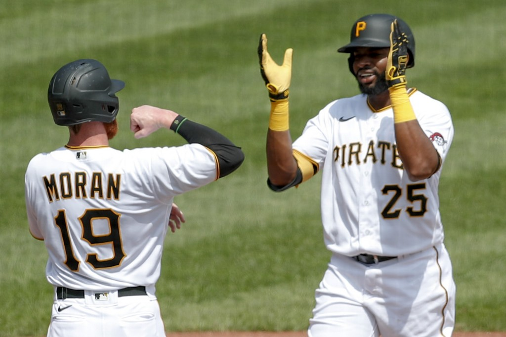 Pittsburgh Pirates' Gregory Polanco (25) celebrates with Colin Moran (19) after driving him and Bryan Reynolds in with a three run home run in the sec...