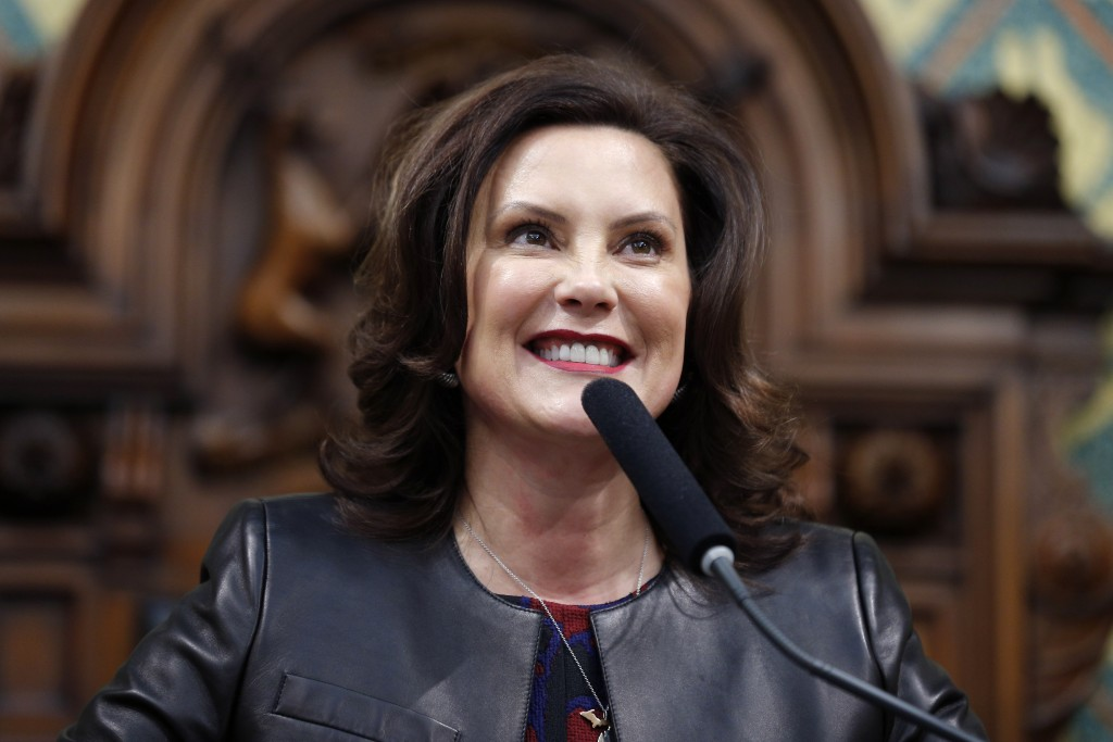 FILE - In this Jan. 29, 2020, file photo, Michigan Gov. Gretchen Whitmer delivers her State of the State address to a joint session of the House and S...