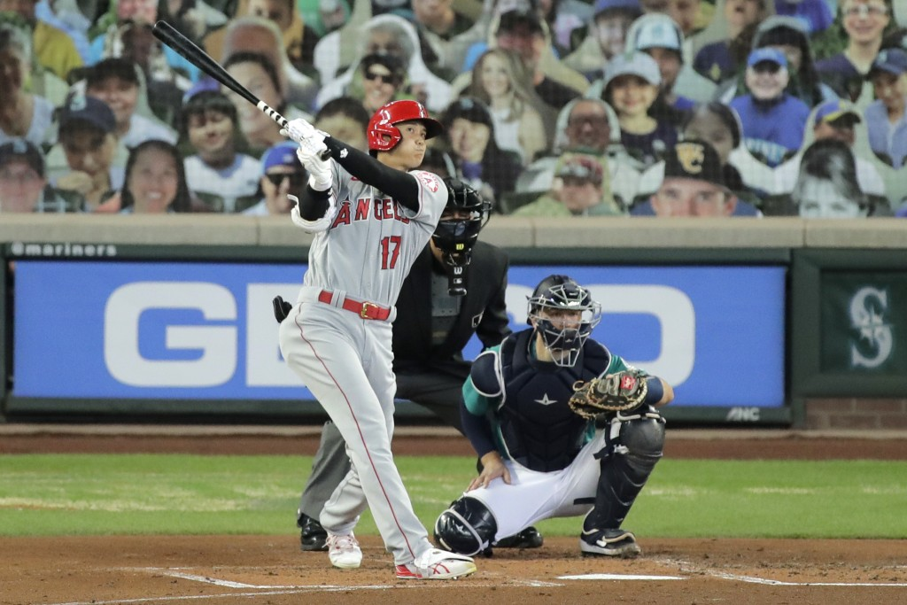Los Angeles Angels' Shohei Ohtani (17) watches his solo home run as Seattle Mariners catcher Joe Hudson, right, looks on during the second inning of a...