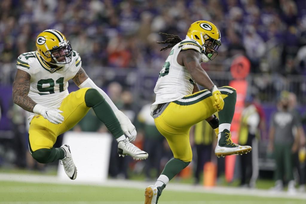 FILE - In this Monday, Dec. 23, 2019, file photo, Green Bay Packers outside linebacker Za'Darius Smith, right, celebrates with teammate Preston Smith ...