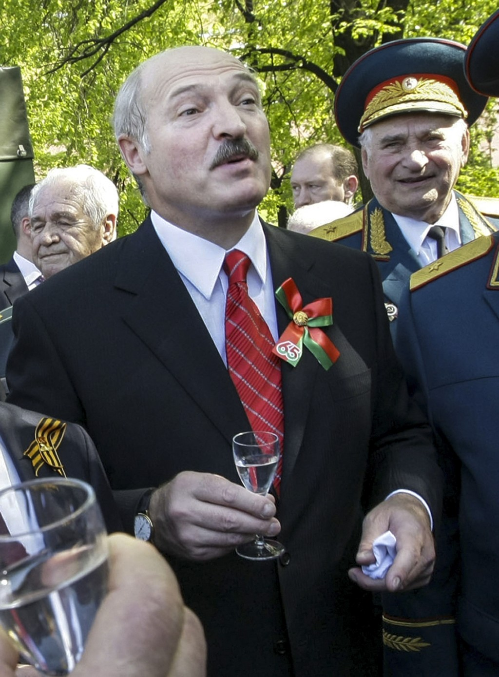 FILE In this file pool photo taken on Saturday, May 8, 2010, Belarusian President Alexander Lukashenko toasts with World War II veterans during an unv...