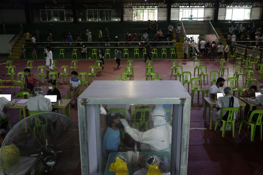 Health worker performs a COVID19 swab test at gymnasium in Navotas city, Philippines.
