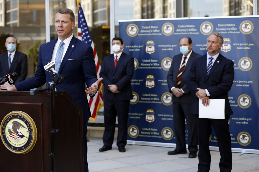 U.S. Attorney Mike Hurst announces Thursday, Aug. 6, 2020, in Jackson, Miss., the indictments of four executives from two Mississippi poultry processi...