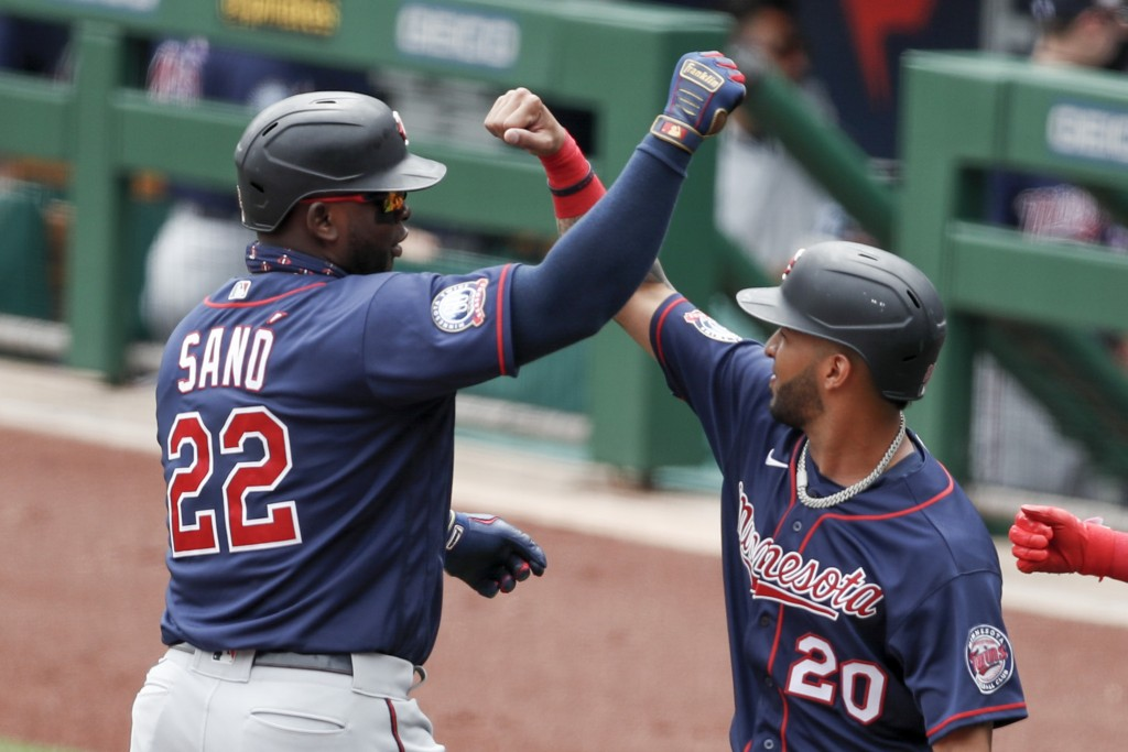 Minnesota Twins' Miguel Sano (22) celebrates with Eddie Rosario (20) after driving him and Jorge Polanco in with a three-run home run in the first inn...