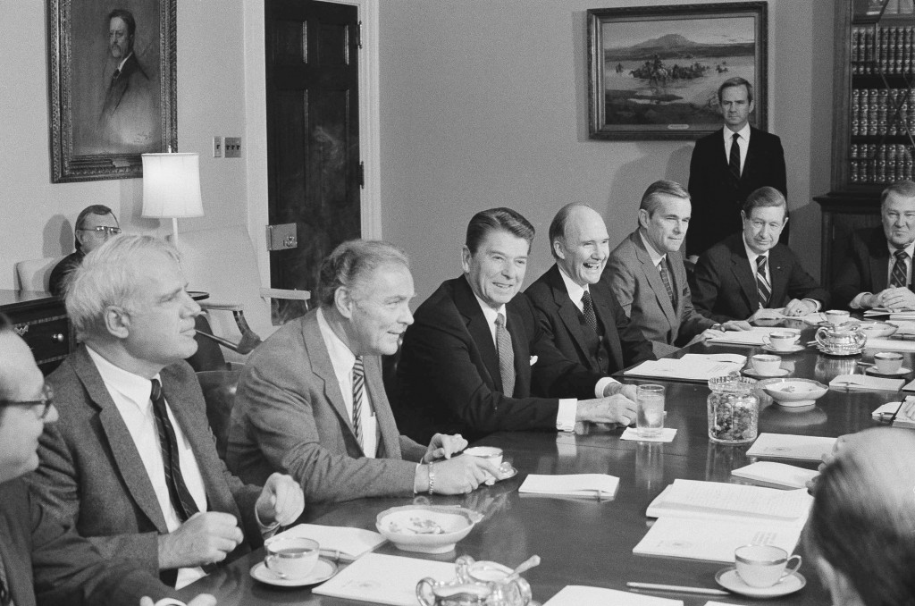 FILE - In this April 12, 1983 file photo, President Ronald Reagan chairs a session of his Commission on Strategic Forces, in the White House Cabinet R...