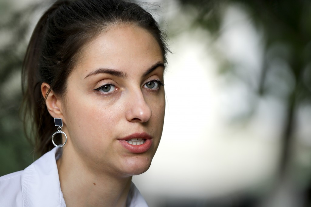 In this photo taken on Wednesday, Aug. 5, 2020, Kseniya Milya, the 26-year old movie producer speaks during her interview with the Associated Press in...