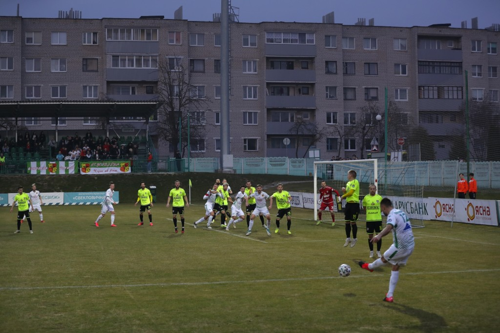 FILE In this photo taken on Saturday, March 28, 2020, Gorodeya's Milan Joksimovic, right back to camera, kicks the ball during the Belarus Championshi...