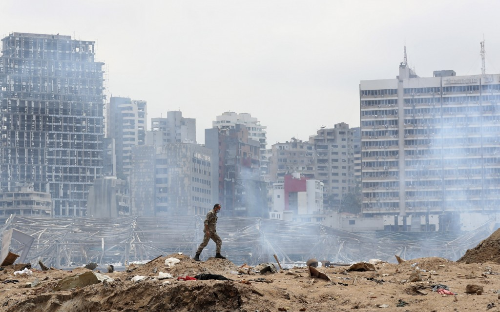 A soldier walks at the devastated site of the explosion in the port of Beirut, Lebanon, Thursday Aug.6, 2020. French President Emmanuel Macron came in...