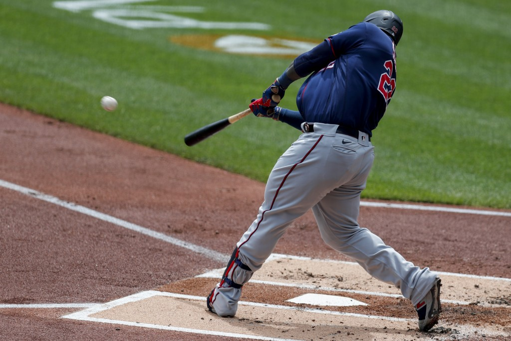 Minnesota Twins' Miguel Sano hits a three-run homer off Pittsburgh Pirates starting pitcher JT Brubaker in the first inning of a baseball game, Thursd...