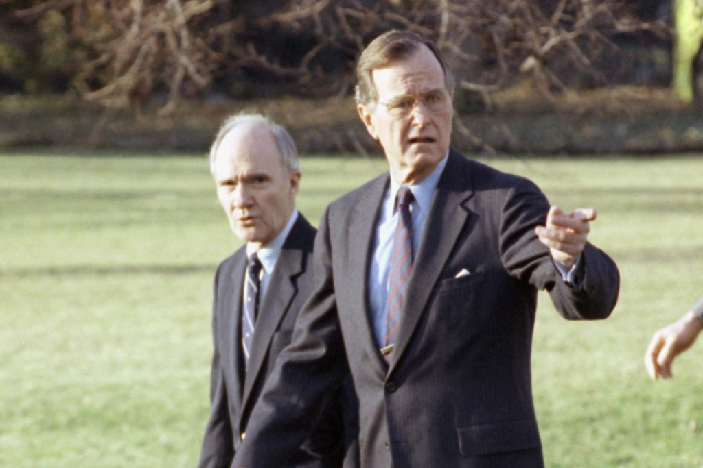 FILE - In this Feb. 6, 1990 file photo, President George H. W. Bush gestures as he and National Security Adviser Brent Scowcroft walk to the president...