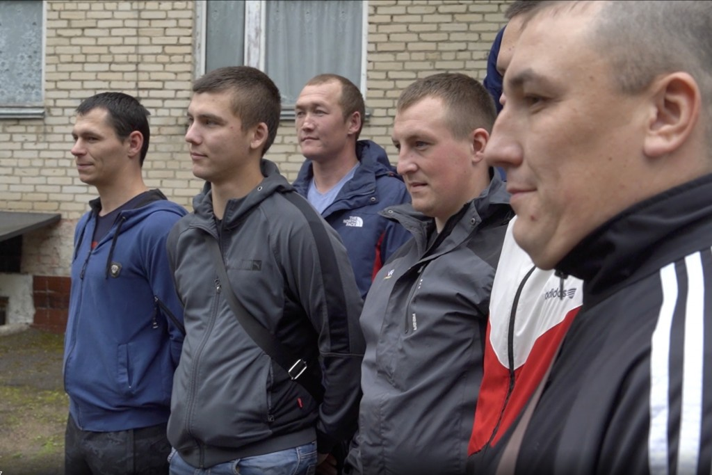 In this photo made from footage provided by the Russian Defense Ministry on Wednesday, July 15, 2020, a group of volunteers participating in a trial o...