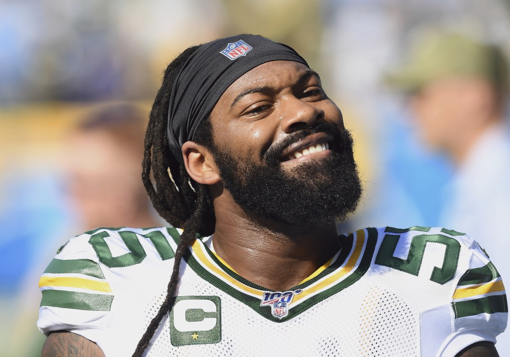 FILE - In this Sunday, Nov. 3, 2019, file photo, Green Bay Packers linebacker Za'Darius Smith (55) smiles towards the stands and a section of Packers ...
