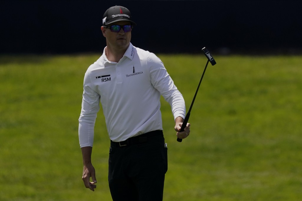Zach Johnson watches his putt on the ninth hole during the first round of the PGA Championship golf tournament at TPC Harding Park Thursday, Aug. 6, 2...