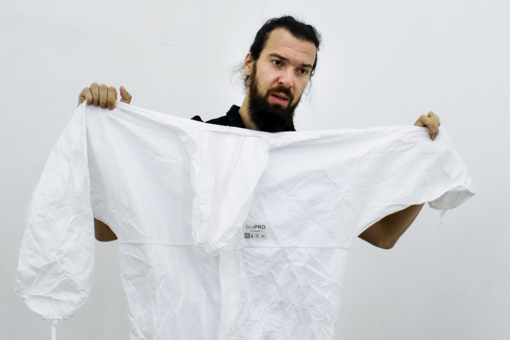 In this photo taken on Wednesday, Aug. 5, 2020, Andrei Tkachev, volunteer, shows a protective gear during his interview with the Associated Press in M...