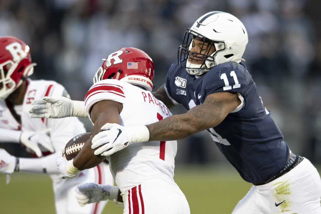 FILE - In this Nov. 30, 2019, file photo, Penn State linebacker Micah Parsons (11) tackles Rutgers tight end Johnathan Lewis (11) in the first quarter...