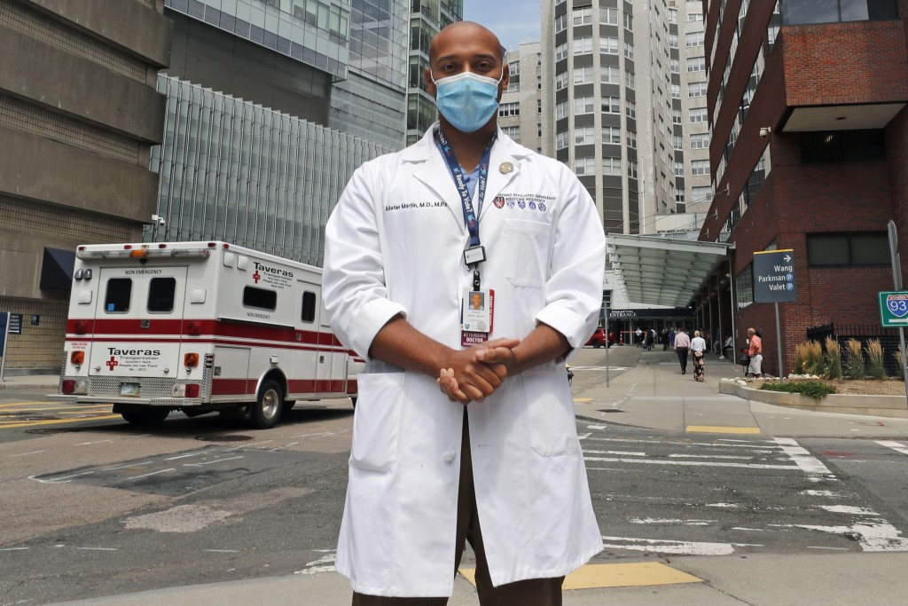 Alister Martin, an emergency room doctor at Massachusetts General Hospital, poses outside the hospital, Friday, Aug. 7, 2020, in Boston. Martin founde...