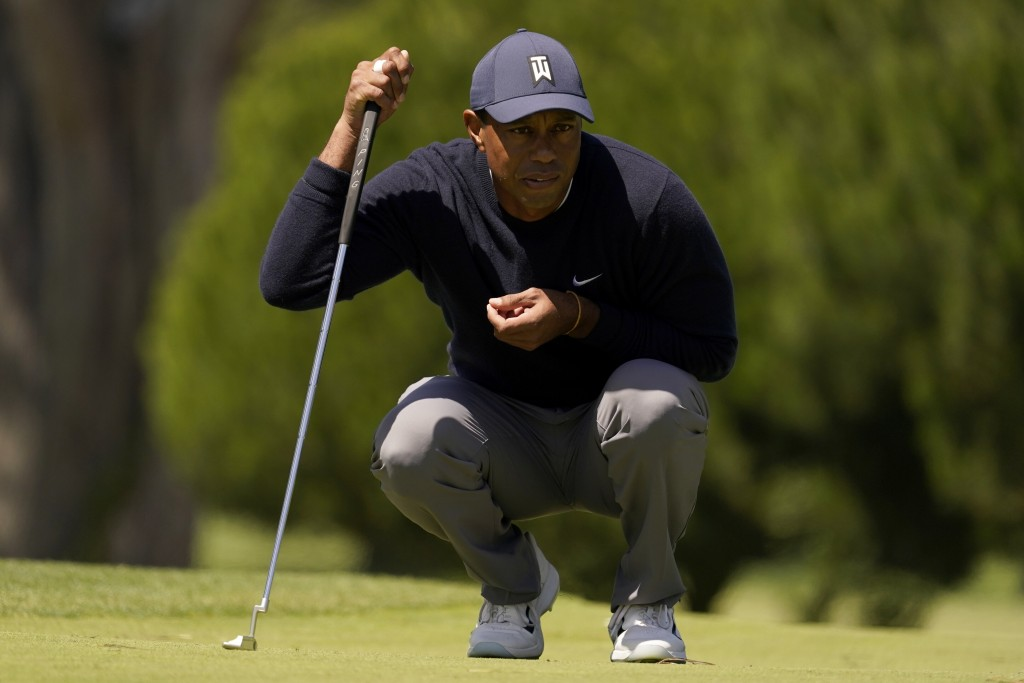 Tiger Woods lines up a putt on the third hole during the second round of the PGA Championship golf tournament at TPC Harding Park Friday, Aug. 7, 2020...