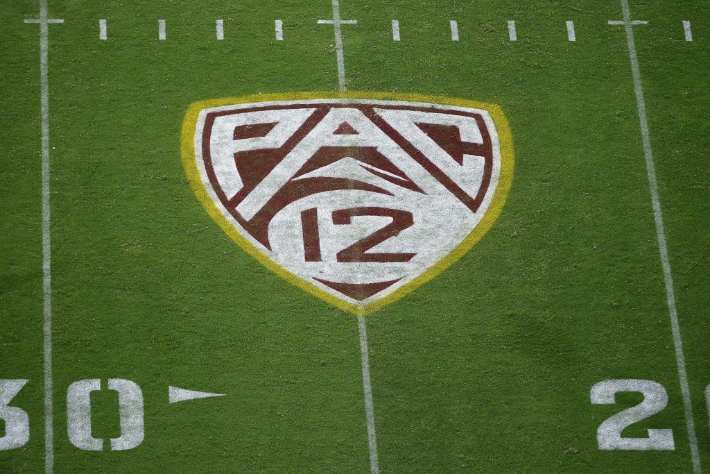 FILE - In this Aug. 29, 2019, file photo, the Pac-12 logo is displayed on the field at Sun Devil Stadium during an NCAA college football game between ...