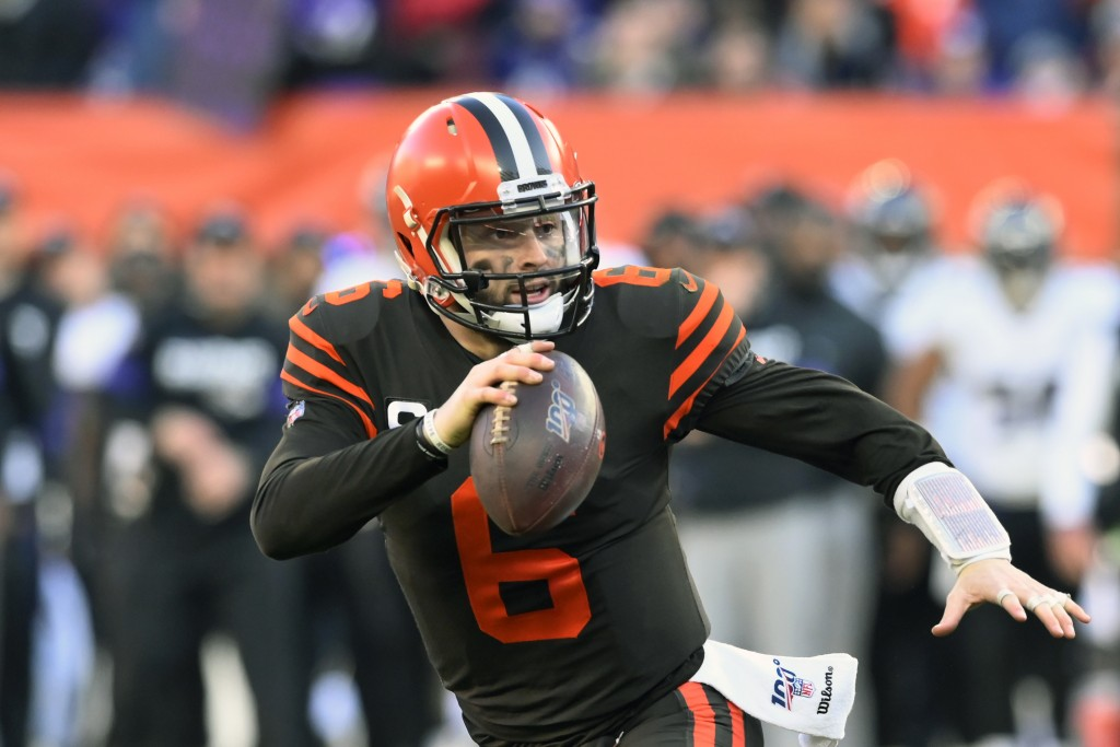 FILE - In this Dec. 22, 2019, file photo, Cleveland Browns quarterback Baker Mayfield scrambles during the second half of an NFL football game against...