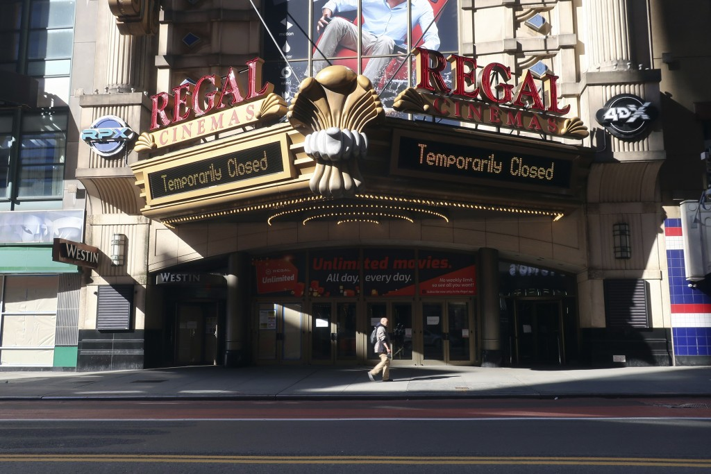 FILE - A Regal Cinemas movie theater is temporarily closed during the coronavirus pandemic in New York on May 5, 2020. Regal movie theaters have been ...