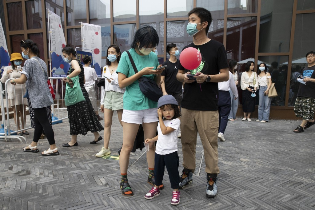 Residents visit a weekend open air market in Beijing on Saturday, Aug. 8, 2020. As the coronavirus outbreak comes under control in the Chinese capital...