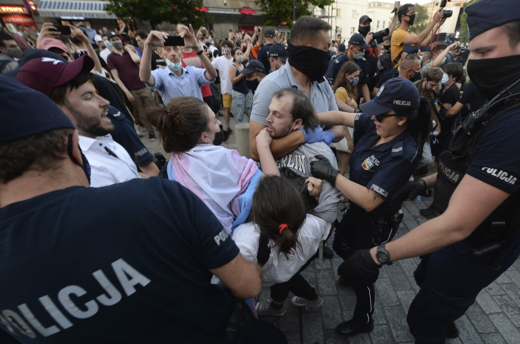 Police scuffle with pro-LGBT protesters angry at the arrest of an LGBT activist in Warsaw Poland on Friday, Aug. 7, 2020.The incident comes amid risin...