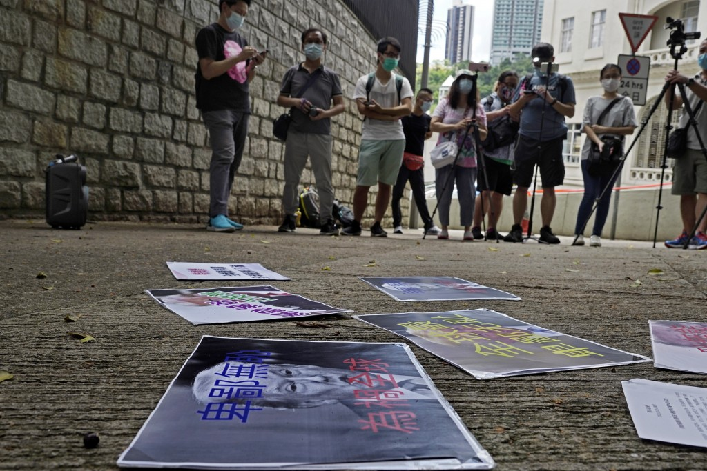 """Pro-China supporters display a picture of U.S. President Donald Trump reading """"Despicable and shameless"""" during a protest against the U.S. sanctions o..."""