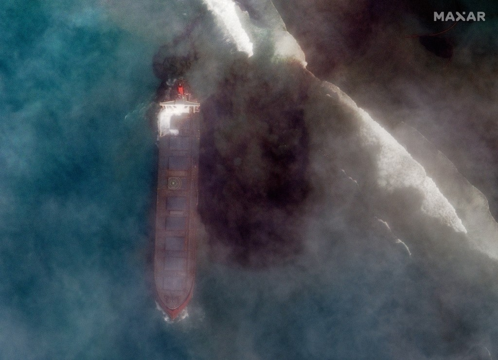 In this satellite image provided by 2020 Maxar Technologies on Friday, Aug. 7, 2020, an aerial view of  oil leaking from the MV Wakashio, a bulk carri...