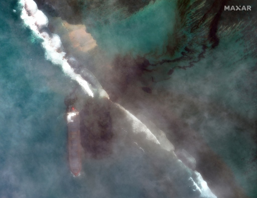 In this satellite image provided by 2020 Maxar Technologies on Friday, Aug. 7, 2020, an aerial view of oil leaking from the MV Wakashio, a bulk carrie...