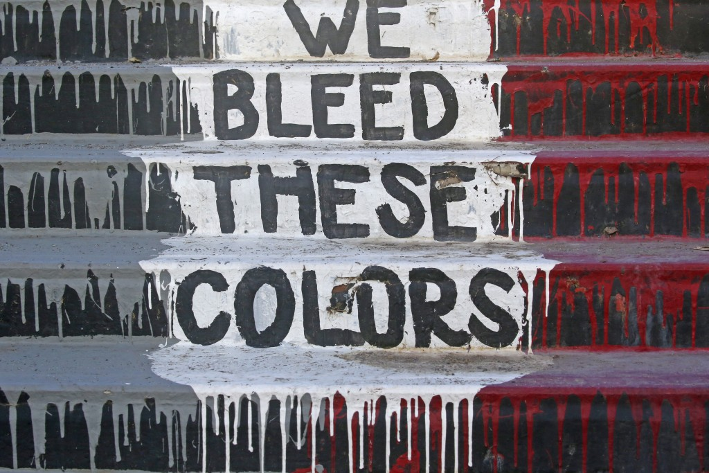 """The phrase """"We Bleed These Colors"""" is shown along a walkway which leads from the Bountiful High School parking lot up to the football field Tuesday, J..."""