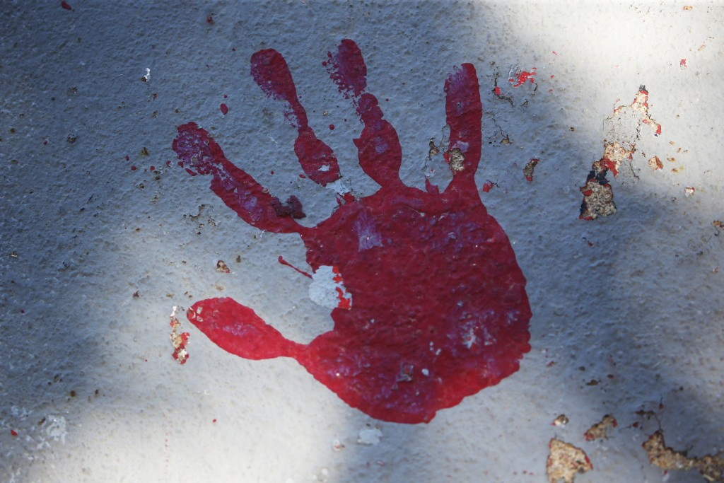A red handprint is painted along a walkway which leads from the Bountiful High School parking lot up to the football field Tuesday, July 28, 2020, in ...