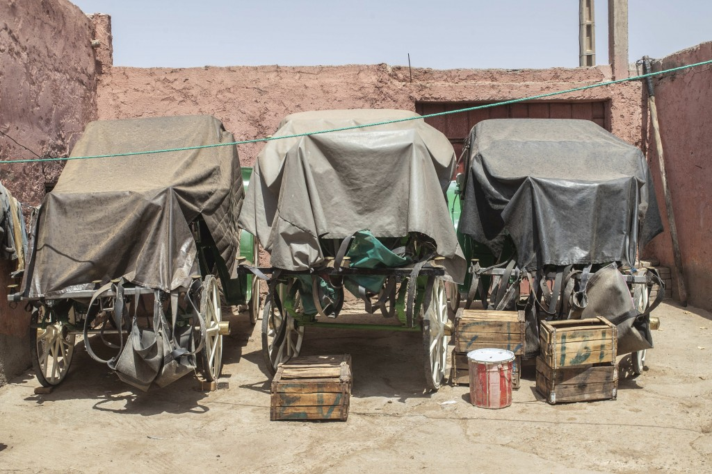 Empty horse-drawn carriages are covered in a stable in Marrakech, Morocco, Wednesday, July 22, 2020. Morocco's restrictions to counter the coronavirus...