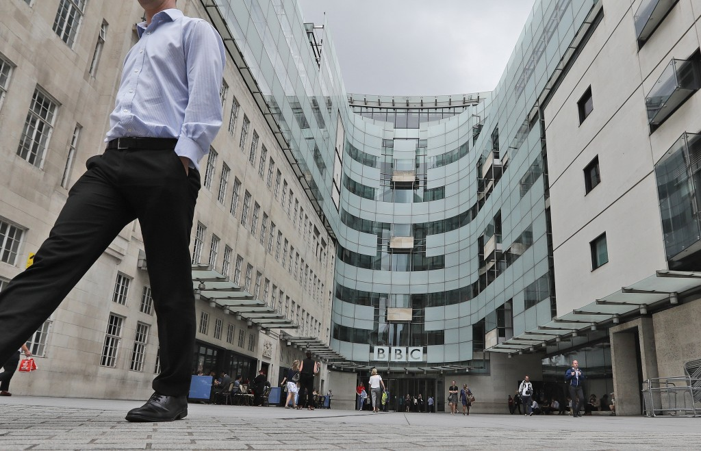 FILE - This Wednesday, July 19, 2017 file photo shows the main entrance to the headquarters of the publicly funded BBC in London. British radio host S...