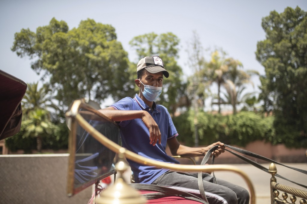 Sabeh Boualili, a horse carriage owner, waits for customers in the landmark Jemma el-Fnaa in Marrakech, Morocco, Wednesday, July 22, 2020. (AP Photo/M...