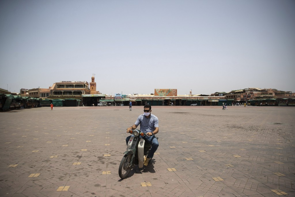A motorcyclist rides his bike in the usually bustling but currently empty Marrakech landmark of Jemma el-Fnaa, Morocco, Wednesday, July 22, 2020. Moro...