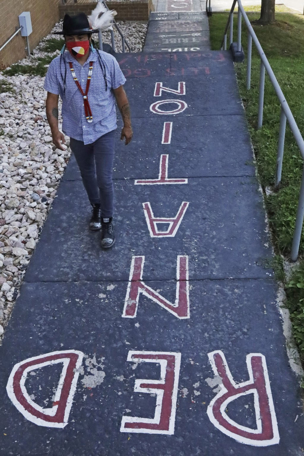 Native American advocate Carl Moore walks along a walkway which leads from the Bountiful High School parking lot up to the football field Tuesday, Jul...