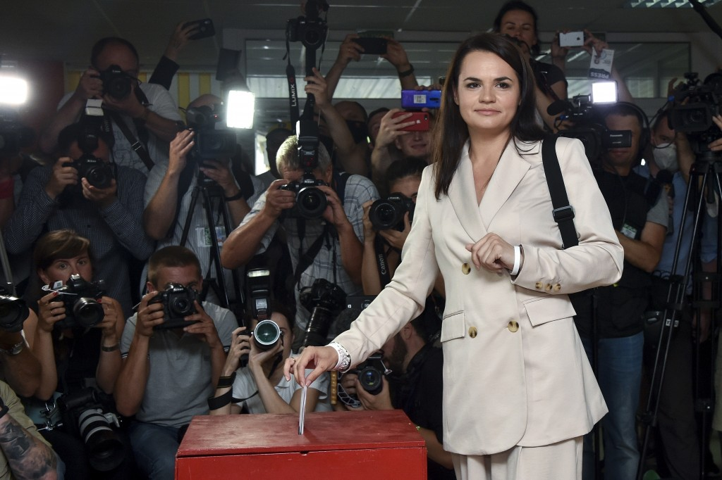 Sviatlana Tsikhanouskaya, candidate for the presidential elections, poses for photographers as she casts her ballot at a polling station during the pr...