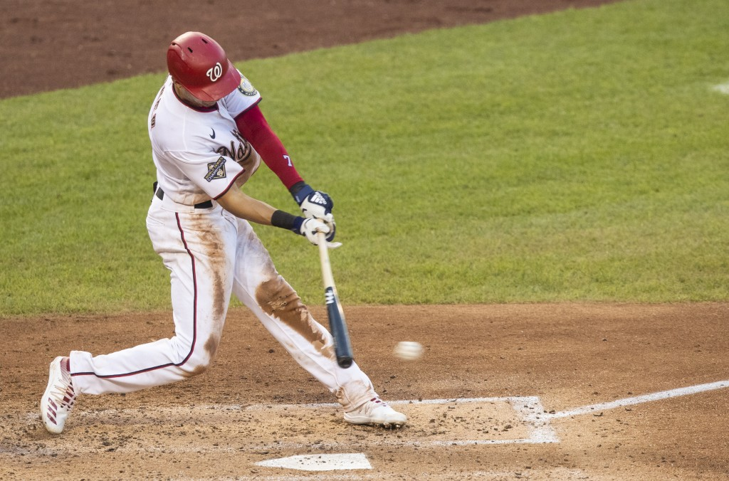 Washington Nationals' Trea Turner hits a single during the fifth inning of a baseball game against the Baltimore Orioles in Washington, Saturday, Aug....
