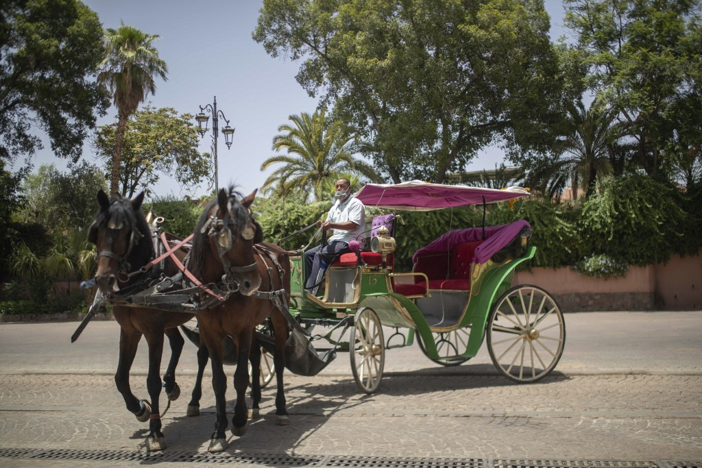 Mohammed El Garbouh, a horse carriage owner, waits for customers in the landmark Jemma el-Fnaa in Marrakech, Morocco, Wednesday, July 22, 2020. Morocc...